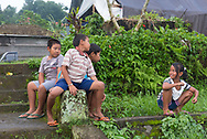 Jatiluwih, Indonesia -- Feb 28, 2016-- Village children playing outside near terraced rice paddies. Editorial Use Only.