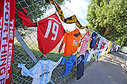 Tributes to Matt Grimstone and Jacob Schilt along the perimeter fence before during the FA Vase 1st Qualifying Round match between Worthing United and East Preston FC at the Robert Eaton Memorial Ground, Worthing, United Kingdom on 6 September 2015. The first home match for Worthing United since losing team mates Matthew Grimstone and Jacob Schilt in the Shoreham air show disaster.