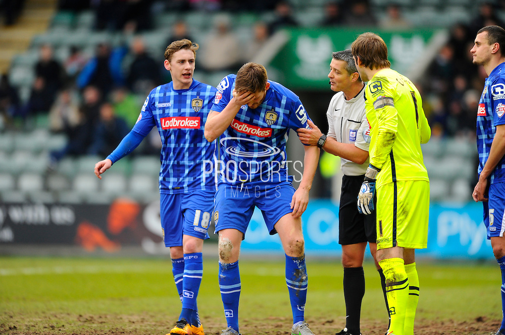 Notts County's Gary MacKenzie his helped to his feet after going down with a head injury during the Sky Bet League 2 match between Plymouth Argyle and Notts County at Home Park, Plymouth, England on 27 February 2016. Photo by Graham Hunt.