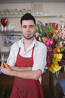 Florist stands with flower arrangement