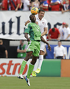 JACKSONVILLE, FL - JUNE 07:  Forward Shola Ameobi #23 of Nigeria goes up for a head ball against defender Matt Besler #5 of the United States during the international friendly match at EverBank Field on June 7, 2014 in Jacksonville, Florida.  (Photo by Mike Zarrilli/Getty Images)