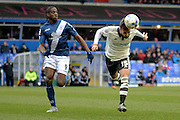 Fulham defender Michael Madl heads the ball away from Birmingham City striker Clayton Donaldson during the Sky Bet Championship match between Birmingham City and Fulham at St Andrews, Birmingham, England on 19 March 2016. Photo by Alan Franklin.