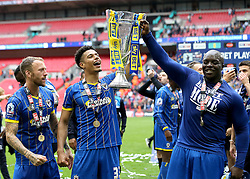 Lyle Taylor of AFC Wimbledon and Adebayo Akinfenwa of AFC Wimbledon celebrate with the League Two Playoff Final Trophy - Mandatory by-line: Robbie Stephenson/JMP - 30/05/2016 - FOOTBALL - Wembley Stadium - London, England - AFC Wimbledon v Plymouth Argyle - Sky Bet League Two Play-off Final