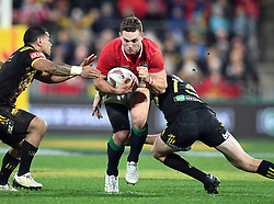 """George North of the Lions, centre, splits the Hurricanes defence in the International rugby match between the the Super Rugby Hurricanes and British and Irish Lions at Westpac Stadium, Wellington, New Zealand, Tuesday, June 27, 2017. Credit:SNPA / Ross Setford  **NO ARCHIVING"""""""
