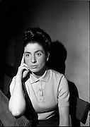 """14/09/1964<br /> 09/14/1964<br /> 14 September 1964<br /> Rehearsal for """"An Triail"""" by Mired Ní Ghrada, which Gael-Linn presented at Damer Hall from the 22/09/1964. It was the only Irish Language contribution to the Dublin Theatre Festival that year. Play was produced by Tomás Mac Anna. Image shows actress Caitlin Maude."""