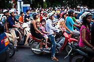 Crowd of vietnamese people riding motorbikes during rush hour, Hanoi, Vietnam, Southeast Asia