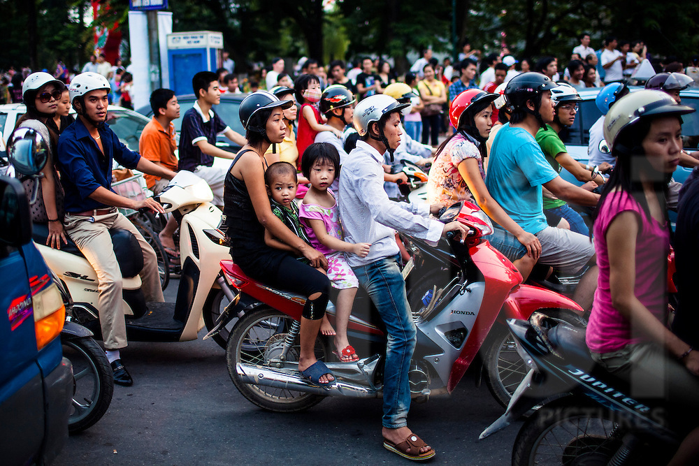 Crowd of vietnamese people riding motorbikes during rush hour, Hanoi, Vietnam, Southeast Asia