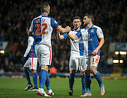 Shane Duffy (Blackburn Rovers) congratulates Craig Conway (Blackburn Rovers) for providing the cross that was turned into Rotherham's goal by their own defender during the Sky Bet Championship match between Blackburn Rovers and Rotherham United at Ewood Park, Blackburn, England on 11 December 2015. Photo by Mark P Doherty.