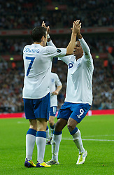 LONDON, ENGLAND - Tuesday, September 6, 2011: England's Ashley Young celebrates with Stewart Downing after scoring his teams first goal during the UEFA Euro 2012 Qualifying Group G match against Wales at Wembley Stadium. (Pic by Gareth Davies/Propaganda)