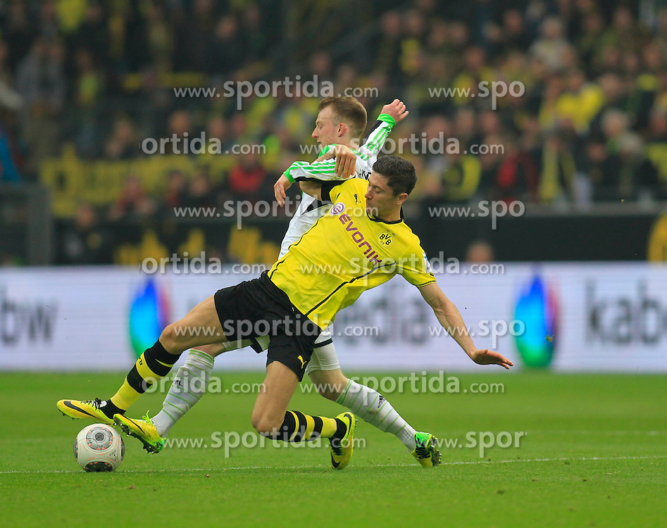 05.04.2014, Signal Iduna Park, Dortmund, GER, 1. FBL, Borussia Dortmund vs VfL Wolfsburg, 29. Runde, im Bild Robert Lewandowski (Borussia Dortmund #9) im Zweikampf gegen / tackling against Maximilian Arnold (VfL Wolfsburg #27) // during the German Bundesliga 29th round match between Borussia Dortmund and VfL Wolfsburg at the Signal Iduna Park in Dortmund, Germany on 2014/04/05. EXPA Pictures &copy; 2014, PhotoCredit: EXPA/ Eibner-Pressefoto/ Schueler<br /> <br /> *****ATTENTION - OUT of GER*****