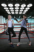 Australian models Bridget Malcolm, left, from Perth and Kelly Gale, right, from Melbourne work out at Aerospace in Manhattan before the upcoming Victoria Secrets fashion show.  (Photo/Stuart Ramson)