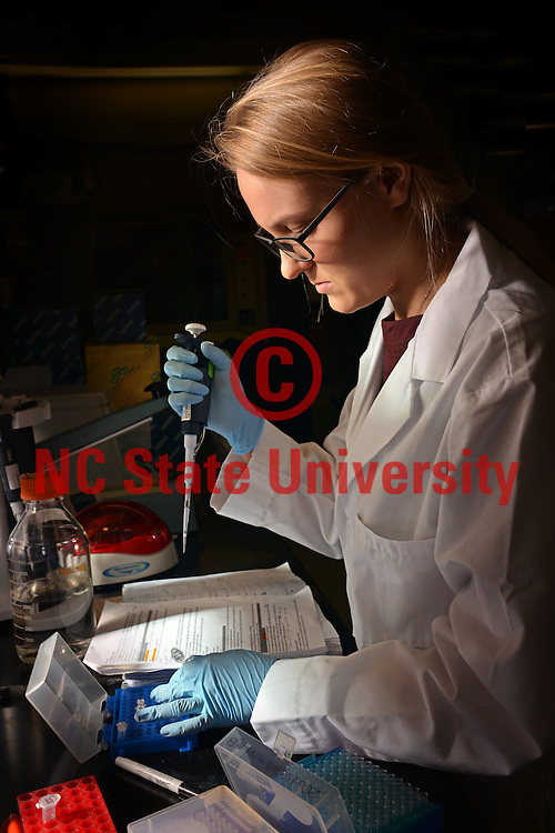 Undergraduate student performs experiment in a Thomas Hall lab.