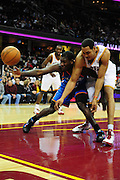 March 13, 2011; Cleveland, OH, USA; Oklahoma City Thunder point guard Royal Ivey (7) and Cleveland Cavaliers center Ryan Hollins (5) fight for a loose ball during the fourth quarter at Quicken Loans Arena. The Thunder beat the Cavaliers 95-75. Mandatory Credit: Jason Miller-US PRESSWIRE