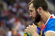 Poland, Krakow - 2017 September 03: Nemanja Petric from Serbia holds the ball before his serve while Third Place match between Belgium and Serbia during LOTTO EUROVOLLEY POLAND 2017 - European Championships in volleyball  at Tauron Arena on September 03, 2017 in Krakow, Poland.<br /> <br /> Mandatory credit:<br /> Photo by &copy; Adam Nurkiewicz<br /> <br /> Adam Nurkiewicz declares that he has no rights to the image of people at the photographs of his authorship.<br /> <br /> Picture also available in RAW (NEF) or TIFF format on special request.<br /> <br /> Any editorial, commercial or promotional use requires written permission from the author of image.