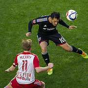 Nov 8, 2015; Harrison, NJ, USA; D.C. United forward Fabian Espindola (10) heads the ball while being defended by New York Red Bulls midfielder Dax McCarty (11) during the second half of the MLS Playoffs at Red Bull Arena. Mandatory Credit: William Hauser-USA TODAY Sports