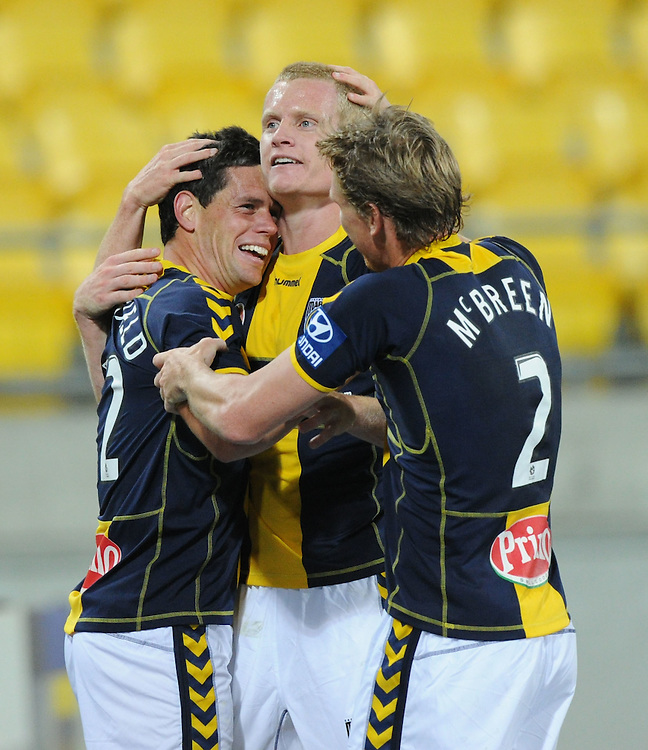 Central Coast Mariners Troy Hearfield, left, celebrates a goal with team mates Matthew Simon and Daniel McBreen against the Phoenix in the A-League football match at Westpac Stadium, Wellington, New Zealand, Friday, November 04, 2011. Credit:SNPA / Ross Setford