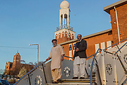Najib Bhudal (left) and Niaz Ahmed, trustees of Birmingham Central Mosque, are walking down the stairs in front of the mosque.