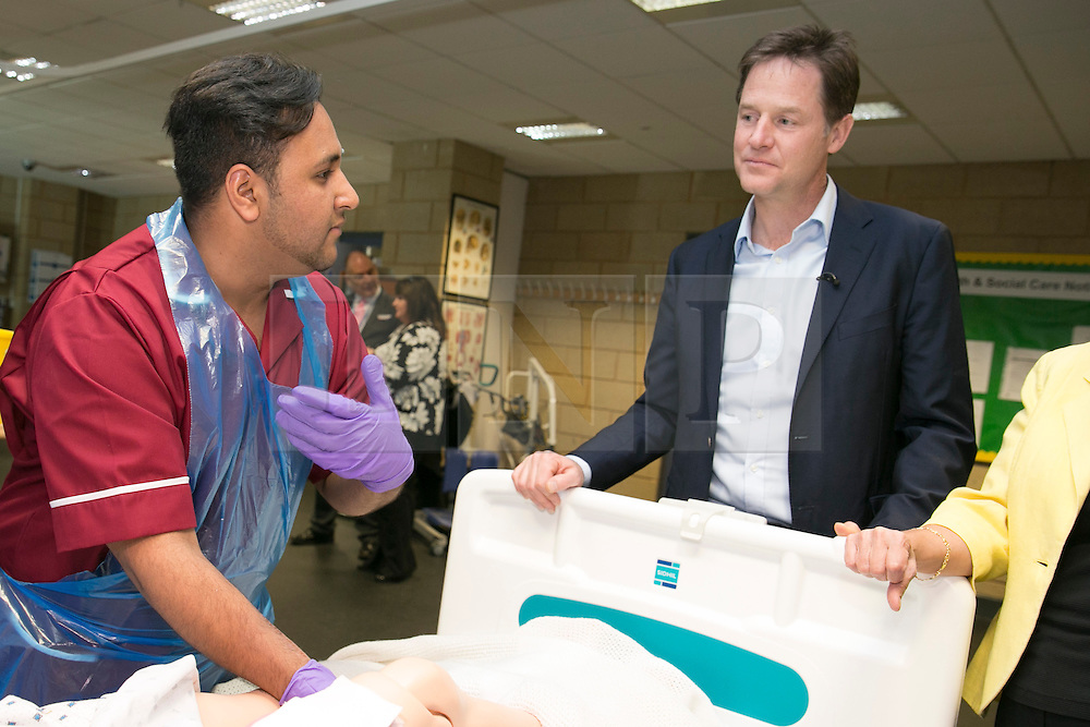 © Licensed to London News Pictures. 01/05/2015. Solihull, West Midlands, UK. Deputy Prime Minister Nick Clegg visiting Solihull College to meet Health and Social Care students. Pictured, Nick Clegg chats to student Fahad Bhimji. Photo credit : Dave Warren/LNP