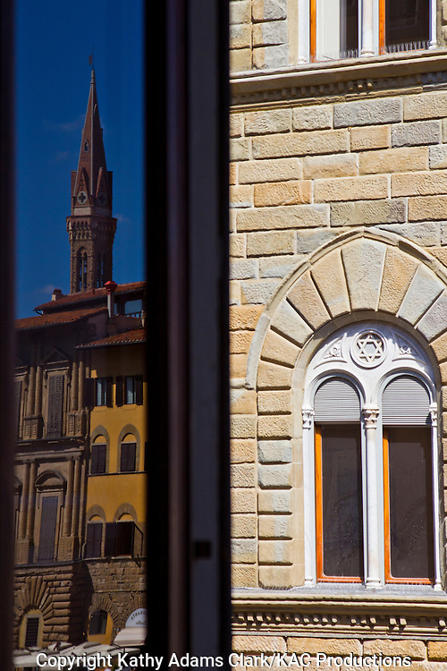 Reflection of buildings in a window above the Piazza della Signoria, in Florence, Firenze, Italy.