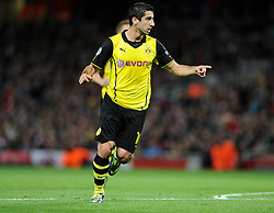 Borrusia Dortmund's Henrik Mkhitaryan celebrates after scoring the opening goal of the game. - Photo mandatory by-line: Alex James/JMP - Tel: Mobile: 07966 386802 22/10/2013 - SPORT - FOOTBALL - Emirates Stadium - London - Arsenal v Borussia Dortmund - CHAMPIONS LEAGUE - GROUP F