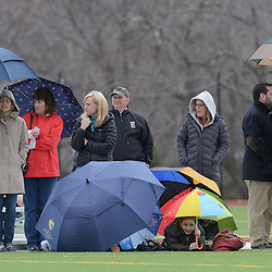 Staff photos by Tom Kelly IV<br /> Three young kids made an umbrella fort on the sidelong of the Episcopal Academy at Notre Dame girls lacrosse game on Tuesday afternoon, March 31, 2015.