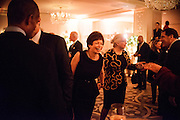 "Photo by Matt Roth.Assignment ID: 10137379A..Valerie Jarrett, senior advisor to President Obama, middle, and her mother Barbara Taylor Bowman, to her left, at the Buffy and Bill Cafritz, Ann and Vernon Jordan, Vicki and Roger Sant inaugural ""Bi-Partisan Celebration"" at the Dolley Madison Ballroom at the Madison Hotel in Washington, D.C. on Monday, January 21, 2013."