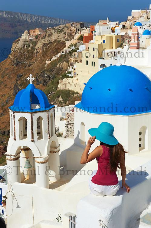 Greece, Cyclades, Santorini island, oia (Ia) village, church with blue dome, tourist