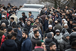 © Licensed to London News Pictures. 06/01/2017. Huddersfield, UK. Crowds around the hearse outside the mosque . The funeral of Yassar Yaqub at Jamia Bilal Mosque in Huddersfield, West Yorkshire. Yaqub, 28, from Huddersfield, was shot dead in a car stopped near junction 24 of the M62 as part of a planned police operation. Photo credit: Joel Goodman/LNP