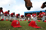 Members of the Premont baseball team gather together for a prayer May 2, 2013 before their playoff game against Port Aransas. After a year with no baseball, the Premont team was able to return to the field strong. The Cowboys were making their first baseball playoff appearance in 10 years.