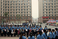 For a story by Dan Levin<br /> FOXCONN<br /> Zhengzhou, June 22nd 2013<br /> The night shift call for female security guards who will patrol the streets and alleys of the new city of 200 000 mostly young people. This factory town has little police force, but hundreds of private security forces keep watch.<br /> Gilles Sabrie for The New York Times