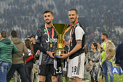 May 19, 2019 - Turin, Turin, Italy - Mattia Perin, Leonardo Bonucci Juventus FC lift the trophy of Scudetto  2018-2019 at Allianz Stadium, Turin  (Credit Image: © Antonio Polia/Pacific Press via ZUMA Wire)