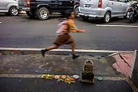 School kid running to school in Ubud. Bali revisited January 2012.