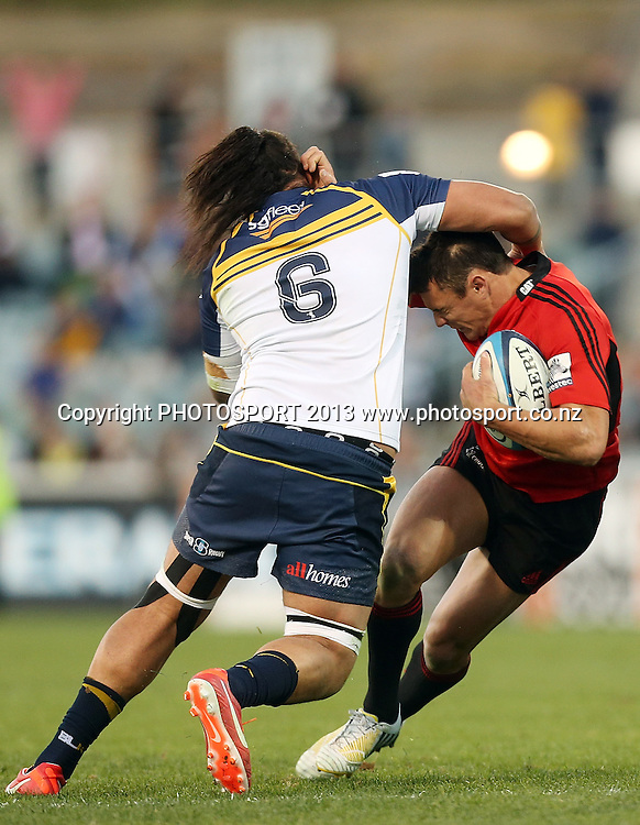 Crusaders' Dan Carter is tackled.  Brumbies v Crusaders. 2013 Investec Super Rugby Season. Canberra Stadium, Canberra, Australia.  Sunday 5 May 2013. Photo: Mark Metcalfe/Photosport.co.nz