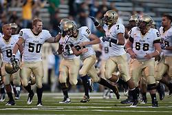 October 10, 2009; San Jose, CA, USA;  Idaho Vandals linebacker Tyler Brooks (50) congratulates Idaho Vandals kicker Trey Farquhar (21) after a field goal in the second quarter against the San Jose State Spartans at Spartan Stadium.  Idaho won 29-25.