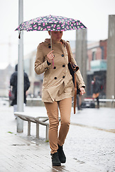 © Licensed to London News Pictures. 14/05/2015. Bristol, UK. A woman with an umbrella braving the wet weather in Bristol city centre today, Thursday 14th May 2015. Photo credit : Rob Arnold/LNP