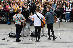 Trafalgar Square, London, July 22nd 2016. International Busking Day is launched in London by Mayor Sadiq Khan together with Jessie Ware, Tinchy Strider, Irish band Keywest and The Vamps. PICTURED: The Vamps perform on the steps of Trafalgar Square to dozens of excited young fans.<br /> <br /> <br /> &copy;Paul Davey<br /> FOR LICENCING CONTACT: Paul Davey +44 (0) 7966 016 296 or 020 8969 6875 paul@pauldaveycreative.co.uk