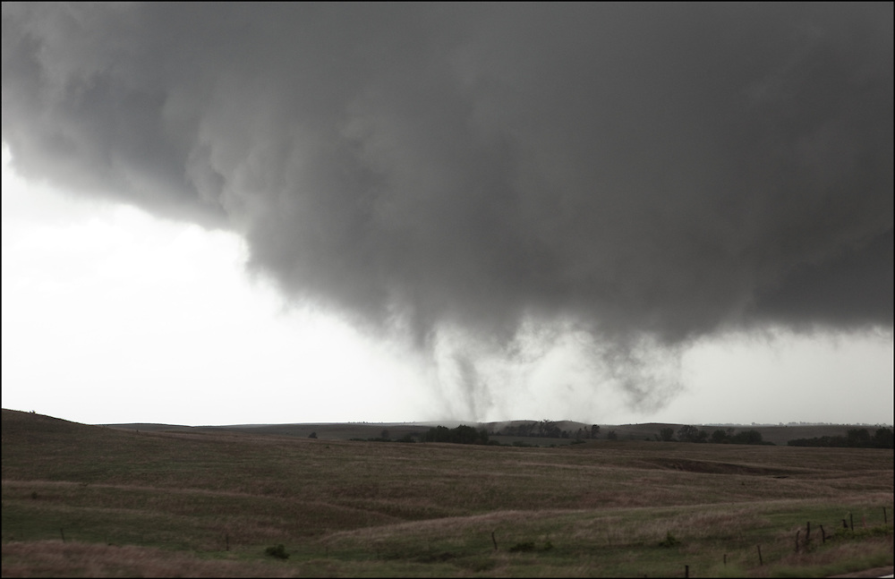 Wide forming tornado in an open field near Lincoln, Kansas.