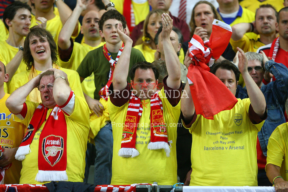 PARIS, FRANCE - WEDNESDAY, MAY 17th, 2006: Arsenal fans watch as their lead is stolen by FC Barcelona during the UEFA Champions League Final at the Stade de France. (Pic by David Rawcliffe/Propaganda)