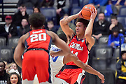Mississippi Rebels forward KJ Buffen (14) is defended by Middle Tennessee Blue Raiders guard Jayce Johnson (10) during an NCAA college basketball game in Nashville, Tenn., Friday, Dec. 21, 2018. (Jim Brown/Image of Sport)