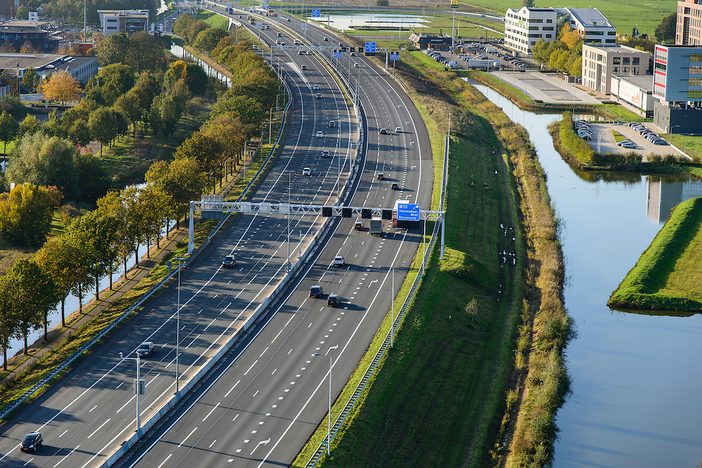 Nederland, Gelderland, Veenendaal, 24-10-2013. Autosnelweg A12 bij bedrijventerrein Veenendaal.<br /> Motorway A12 near Veenendaal, central Netherlands, business park right.<br /> luchtfoto (toeslag op standaard tarieven);<br /> aerial photo (additional fee required);<br /> copyright foto/photo Siebe Swart.