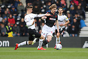 Derby County forward Tom Lawrence challenges Bolton Wanderers defender Luca Connell during the EFL Sky Bet Championship match between Derby County and Bolton Wanderers at the Pride Park, Derby, England on 13 April 2019.