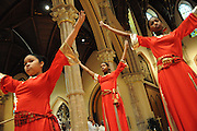 "Chicago Catholic Schools liturgical dancers (L to R) Renisha Malik, 14, JaNiece Washington, 16, and Zoie Horton, 12, celebrate the 33rd Annual African American Heritage Month Eucharistic Celebration at Holy Name Cathedral. This year's mass celebrates the the Nguzo Saba principle of Kuumba, or ""creativity"" at Holy Name Cathedral."