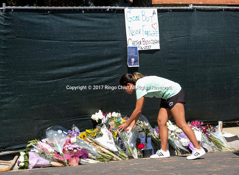 Fans place flowers at a memorial site outside of the home of Chester Bennington in Palos Verdes Estates, California, on Friday, July 21, 2017. Chester Bennington, lead singer of alt-rock band Linkin Park, was found dead on Thursday morning in his Palos Verdes Estates home of an apparent suicide. He was 41.(Photo by Ringo Chiu)<br /> <br /> Usage Notes: This content is intended for editorial use only. For other uses, additional clearances may be required.