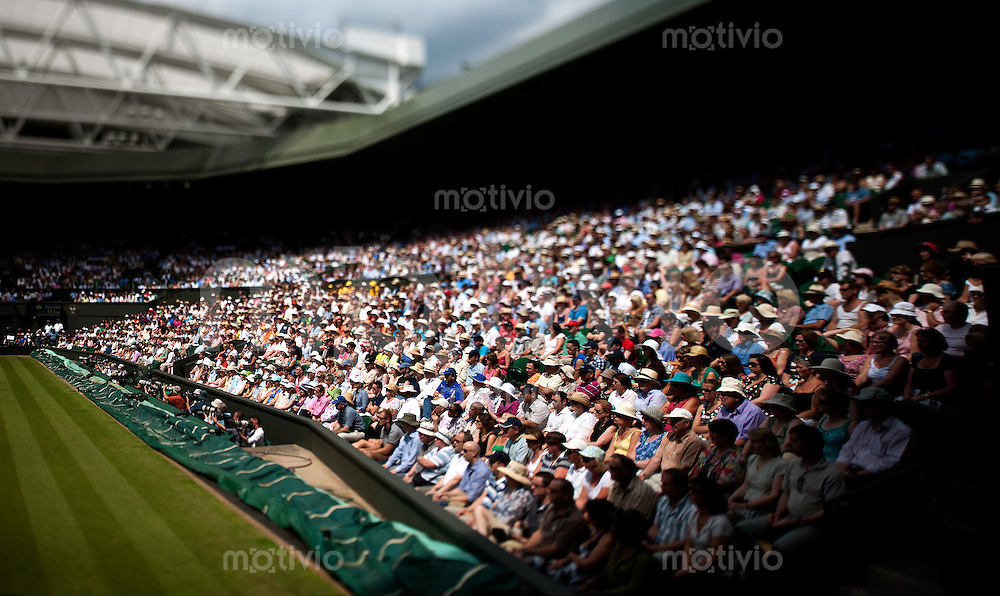 Spectators watch a match on Centre Court. The Wimbledon Championships 2010 The All England Lawn Tennis & Croquet Club  Day 5 Friday 25/06/2010