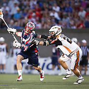 Kevin Buchanan #27 of the Boston Cannons keeps the ball away from Kyle Denhoff #25 of the Rochester Rattlers during the game at Harvard Stadium on August 9, 2014 in Boston, Massachusetts. (Photo by Elan Kawesch)