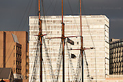 An old tallship in Liverpool's Albert Dock, contrasts strikingly against the huge modern developements behind
