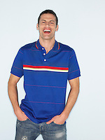 Man smiling in studio half length