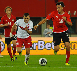 06.09.2011, Ernst Happel Stadion, Wien, AUT, UEFA EURO 2012, Qualifikation, Oesterreich (AUT) vs Tuerkei (TUR), im Bild Zweikampf zwischen Yekta Kurtulus, (TUR, #5) und Martin Harnik, (AUT, #19) // during the UEFA Euro 2012 Qualifier Game, Austria vs Turkey, at Ernst Happel Stadium, Vienna, 2011-09-06, EXPA Pictures © 2011, PhotoCredit: EXPA/ M. Gruber
