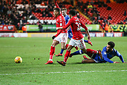 Aaron Holloway of Oldham Athletic makes a slide tackle during the EFL Sky Bet League 1 match between Charlton Athletic and Oldham Athletic at The Valley, London, England on 6 January 2018. Photo by Toyin Oshodi.