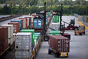 Top loaders work the Mason Rail Yard at the Georgia Ports Authority Garden City Terminal, Wednesday, Aug. 19 2015, in Garden City, Ga.  (GPA Photo/Stephen B. Morton)